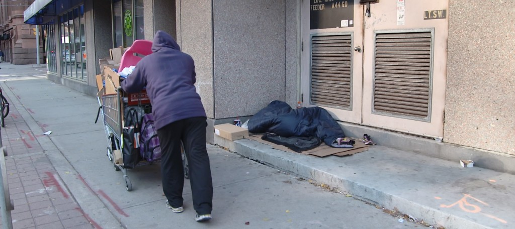 Homeless man in Toronto checks on another man who's sleeping rough