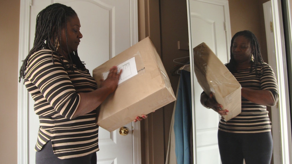 Jackie Christopher with the box that was returned to her after the inquest into her son's death in a police shooting. It almost certainly contains the clothes he died in